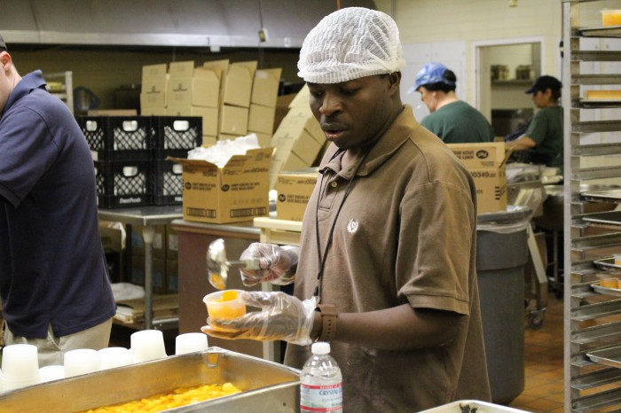 Young Person With Disability Working in Food Prep
