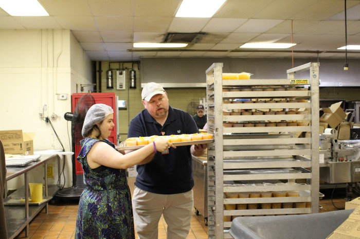 Job Coach Helping Young Person Stack Food Tray
