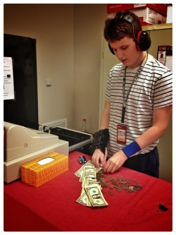 Evan Shouse counts money in his Transitions II class